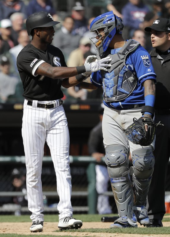 Chicago White Sox's Tim Anderson, left, talks to Kansas City Royals catcher Martin Maldonado after being hit by a pitch during the sixth inning of a baseball game in Chicago, Wednesday, April 17, 2019. (AP Photo/Nam Y. Huh)