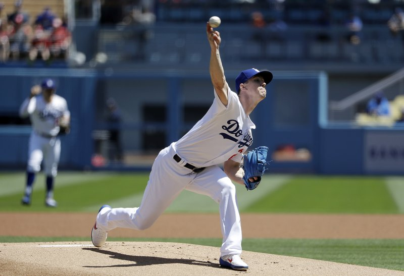 Los Angeles Dodgers starting pitcher Walker Buehler throws to the Cincinnati Reds during the first inning of a baseball game Wednesday, April 17, 2019, in Los Angeles. (AP Photo/Marcio Jose Sanchez)