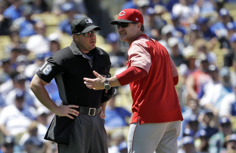 Cincinnati Reds manager David Bell, right, argues with home plate umpire Nick Mahrley after being tossed during the fifth inning of a baseball game against the Los Angeles Dodgers Wednesday, April 17, 2019, in Los Angeles. (AP Photo/Marcio Jose Sanchez)