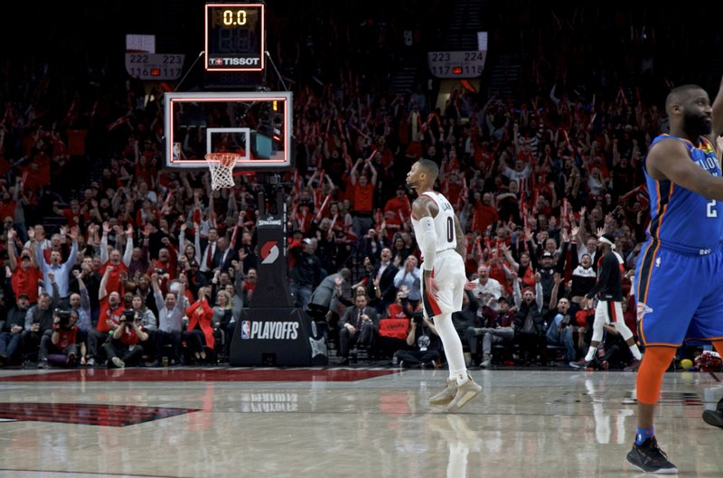 Portland Trail Blazers guard Damian Lillard reacts after making a 3-point basket against the Oklahoma City Thunder during the second half of Game 2 of an NBA basketball first-round playoff series Tuesday, April 16, 2019, in Portland, Ore. (AP Photo/Craig Mitchelldyer)