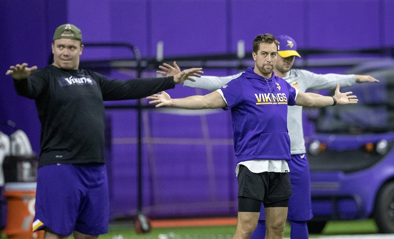 Minnesota Vikings wide receiver Adam Thielen, right foreground, stretches before practice at the Twin Cities Orthopedic Center in Eagan, Minn., Tuesday, April 16, 2019. Elizabeth Flores/Star Tribune via AP)