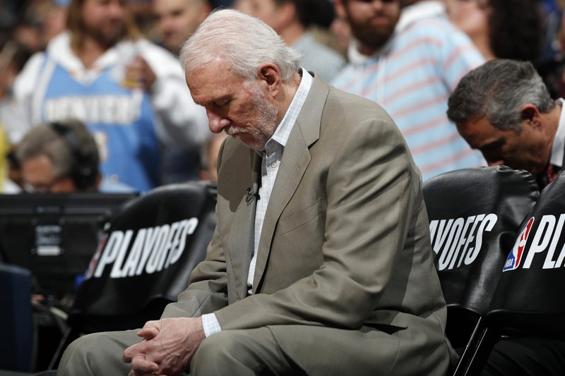 San Antonio Spurs head coach Gregg Popovich sits on the bench before facing the Denver Nuggets in the first half of Game 2 of an NBA basketball playoff series, Tuesday, April 16, 2019, in Denver. (AP Photo/David Zalubowski)