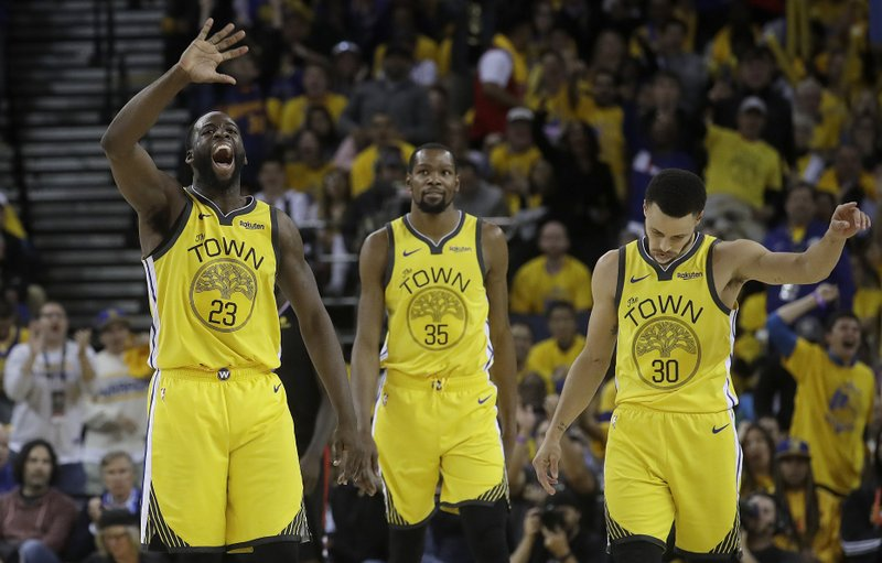 Golden State Warriors forward Draymond Green (23), forward Kevin Durant (35) and guard Stephen Curry (30) react after Los Angeles Clippers guard Patrick Beverley fouled out during the second half of Game 2 of a first-round NBA basketball playoff series in Oakland, Calif. (AP Photo/Jeff Chiu)