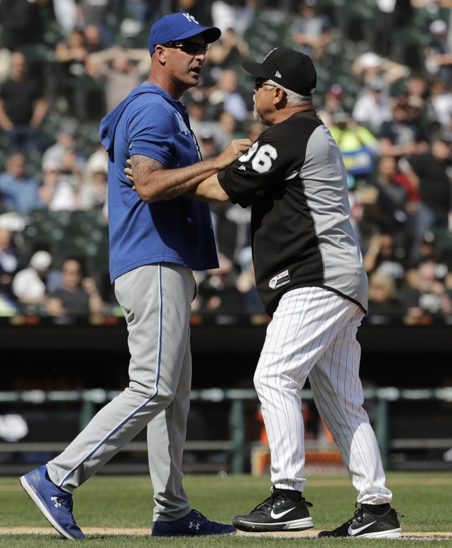 Kansas City Royals bench coach Dale Sveum, left, and Chicago White Sox manager Rick Renteria shove each other as benches clear after Chicago White Sox's Tim Anderson was hit by a pitch during the sixth inning of a baseball game in Chicago, Wednesday, April 17, 2019. (AP Photo/Nam Y. Huh)