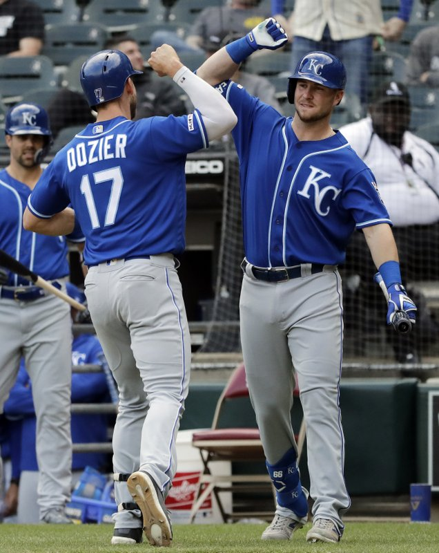 Kansas City Royals' Hunter Dozier, left, celebrates with Ryan O'Hearn after hitting a solo home run against the Chicago White Sox during the 10th inning of a baseball game in Chicago, Wednesday, April 17, 2019. (AP Photo/Nam Y. Huh)