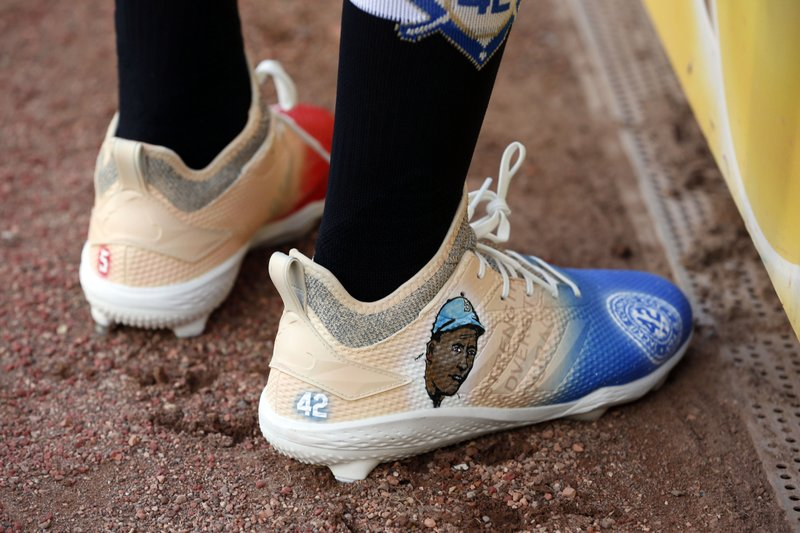 Texas Rangers' Delino DeShields wears shoes with Jackie Robinson's image prior to playing the Los Angels Angels in a baseball game Monday, April 15, 2019, in Arlington, Texas. (AP Photo/Michael Ainsworth)