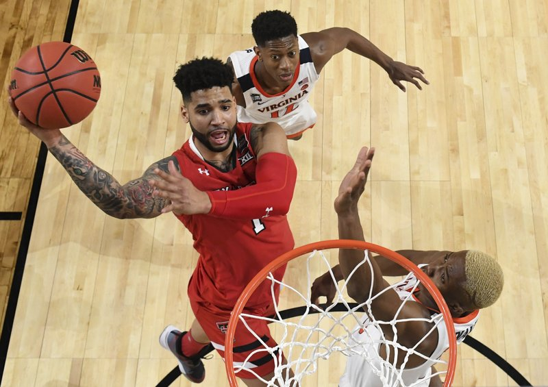 Texas Tech's Brandone Francis (1) goes up for a shot against Virginia's Mamadi Diakite during the second half in the championship of the Final Four NCAA college basketball tournament, Monday, April 8, 2019, in Minneapolis. (Brett Wilhelm/NCAA Photos via Getty Images via AP, Pool)