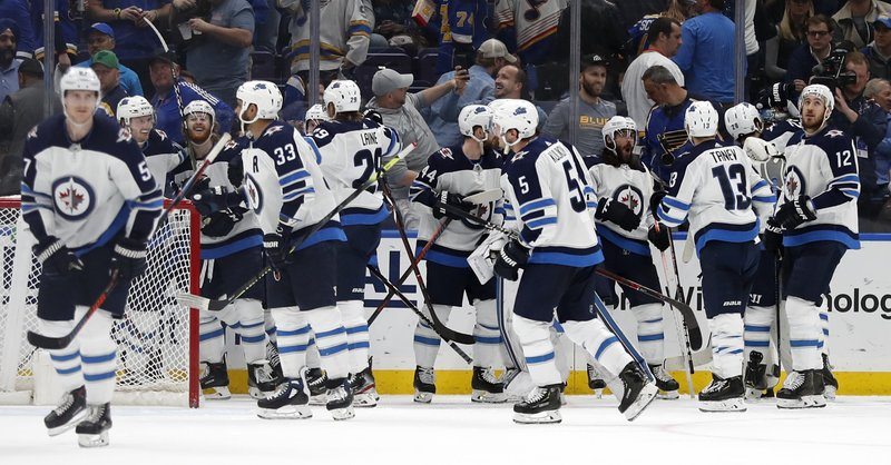 The Winnipeg Jets celebrate after defeating the St. Louis Blues 2-1 in overtime in Game 4 of an NHL hockey first-round playoff series Tuesday, April 16, 2019, in St. (AP Photo/Jeff Roberson)