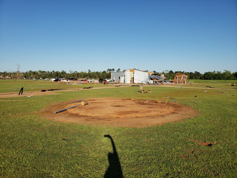This Sunday, April 14, 2019, photo provided by the Texas Historical Commission shows an empty mound after a grass house at a Native American historic site called Caddo Mounds was lifted by a twister and hurled it into the distance with two people still inside in Alto, Texas. (Chris Florance/Texas Historical Commission via AP)