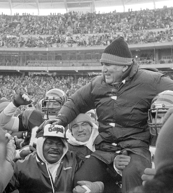FILE - In this Jan. 10, 1982, file photo, Cincinnati Bengals coach Forrest Gregg is carried off the field by players and fans after the Bengals defeated the San Diego Chargers in the AFC Championship playoff game in Cincinnati, Ohio. (AP Photo/File)