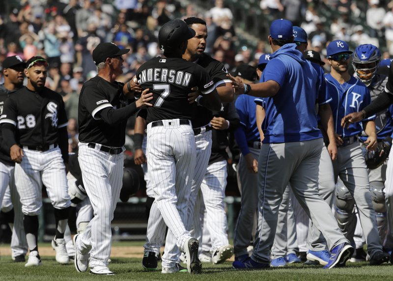 Chicago White Sox's Tim Anderson (7) is restrained by Jose Abreu after he was hit by a pitch from the Kansas City Royals, as benches cleared during the sixth inning of a baseball game in Chicago, Wednesday, April 17, 2019. (AP Photo/Nam Y. Huh)