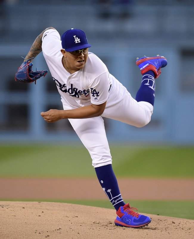 Los Angeles Dodgers starting pitcher Julio Urias follows through during the first inning of the team's baseball game against the Milwaukee Brewers on Friday, April 12, 2019, in Los Angeles. (AP Photo/Mark J. Terrill)