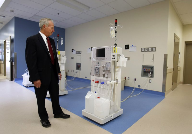 FILE - In this Tuesday, June 25, 2013 file photo, Jeffrey Beard, secretary of the California Department of Corrections and Rehabilitation, looks over a dialysis machine while touring the new California Correctional Health Care Facility during dedication day festivities. (AP Photo/Rich Pedroncelli, File)