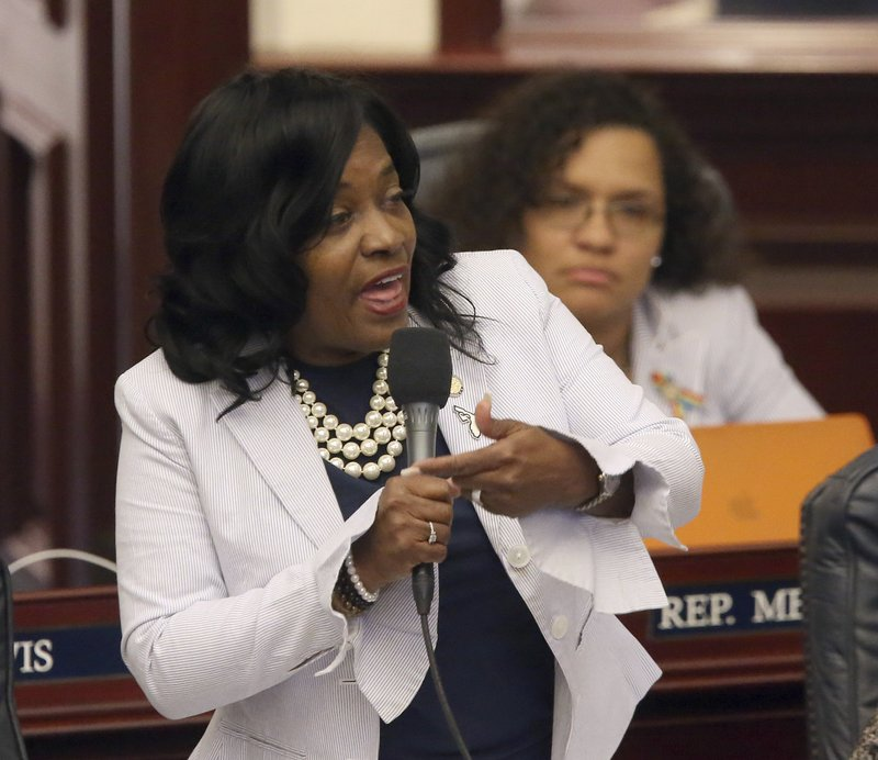 Rep. Dianne Hart, D-Tampa, asks a question about a parental abortion consent bill during session, Wednesday, April 17, 2019, in Tallahassee, Fla. (AP Photo/Steve Cannon)