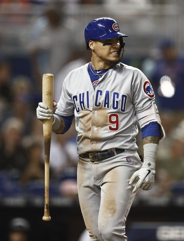 Chicago Cubs' Javier Baez reacts to striking out during the fifth inning of the team's baseball game against the Miami Marlins on Wednesday, April 17, 2019, in Miami. (AP Photo/Brynn Anderson)