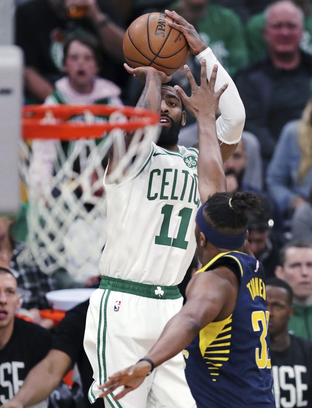 Boston Celtics guard Kyrie Irving (11) shoots over Indiana Pacers center Myles Turner (33) during the first quarter of Game 2 of an NBA basketball first-round playoff series, Wednesday, April 17, 2019, in Boston. (AP Photo/Charles Krupa)