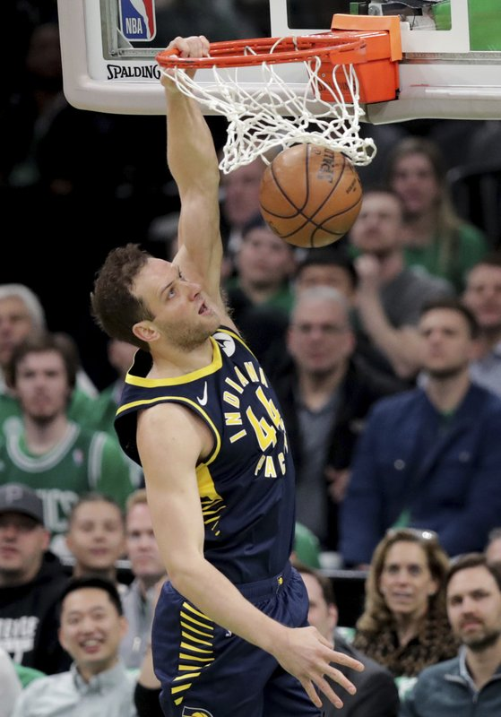 Indiana Pacers forward Bojan Bogdanovic (44) slams a dunk against the Boston Celtics during the first quarter of Game 2 of an NBA basketball first-round playoff series, Wednesday, April 17, 2019, in Boston. (AP Photo/Charles Krupa)