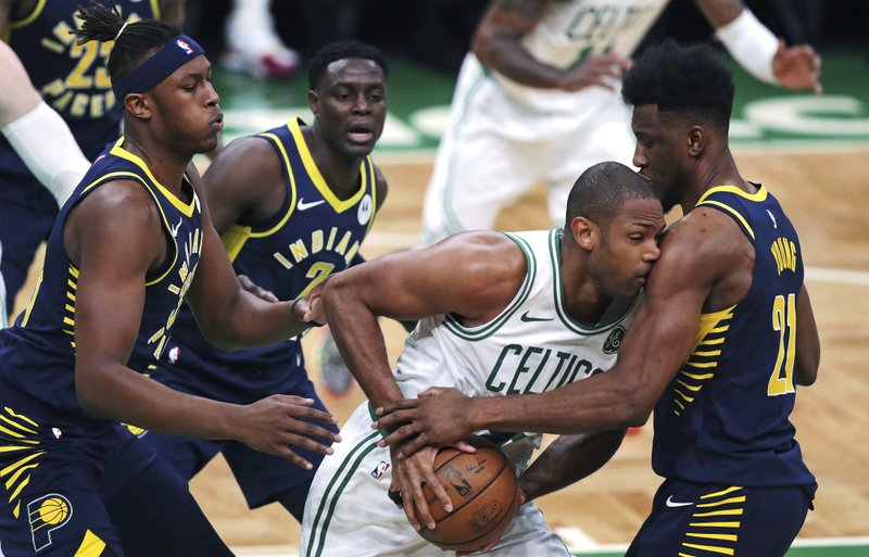 Boston Celtics center Al Horford, is trapped by Indiana Pacers forward Thaddeus Young, right, during the first quarter of Game 2 of an NBA basketball first-round playoff series, Wednesday, April 17, 2019, in Boston. (2)(AP Photo/Charles Krupa)