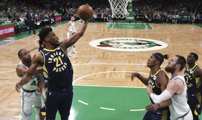Indiana Pacers forward Thaddeus Young (21) grabs a rebound against the Boston Celtics during the first quarter of Game 2 of an NBA basketball first-round playoff series, Wednesday, April 17, 2019, in Boston. (AP Photo/Charles Krupa)