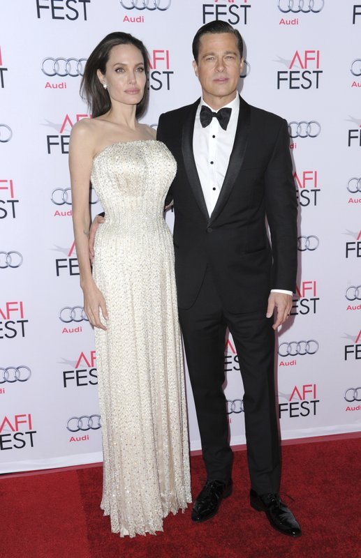 FILE - In this Nov. 5, 2015 file photo, Angelina Jolie, left, and Brad Pitt arrive at the 2015 AFI Fest opening night premiere of