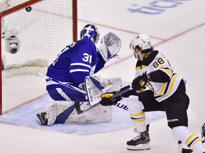 Boston Bruins right wing David Pastrnak (88) scores on Toronto Maple Leafs goaltender Frederik Andersen (31) during the second period of Game 4 of an NHL hockey first-round playoff series Wednesday, April 17, 2019, in Toronto. (Frank Gunn/The Canadian Press via AP)