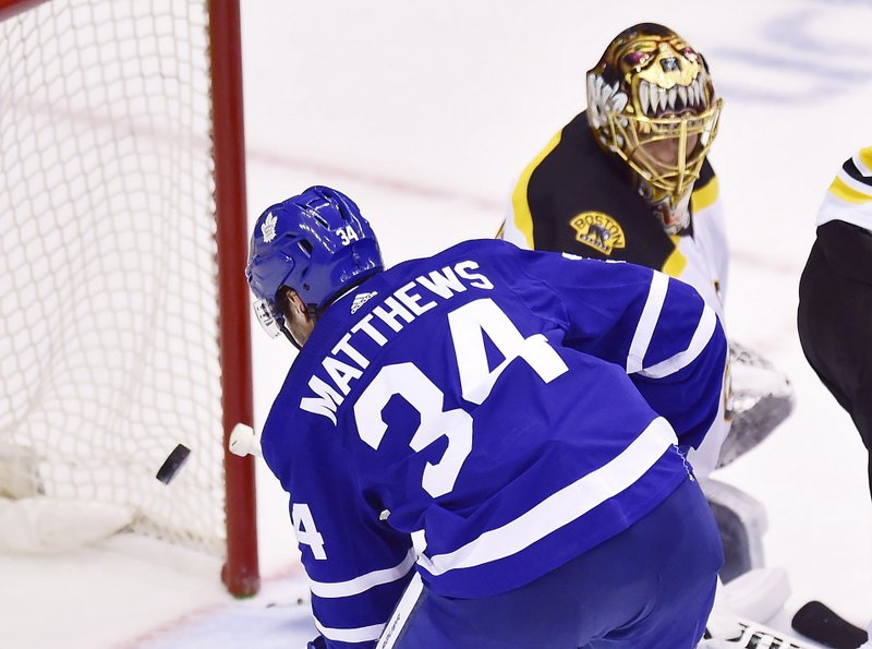 Toronto Maple Leafs center Auston Matthews (34) scores on Boston Bruins goaltender Tuukka Rask (40) during the third period of Game 4 of an NHL hockey first-round playoff series Wednesday, April 17, 2019, in Toronto. (Frank Gunn/The Canadian Press via AP)