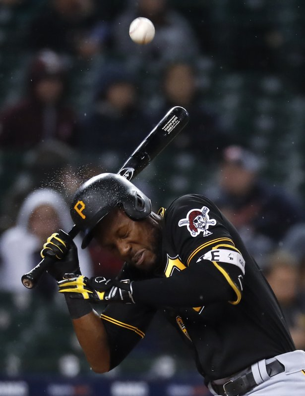 Pittsburgh Pirates' Starling Marte is hit in the helmet by Detroit Tigers relief pitcher Joe Jimenez in the eighth inning of a baseball game in Detroit, Wednesday, April 17, 2019. (AP Photo/Paul Sancya)