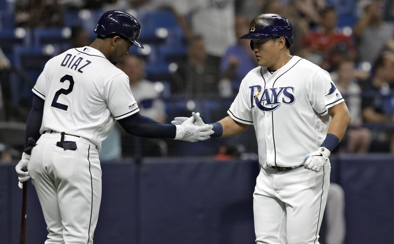 Tampa Bay Rays' Ji-Man Choi, right, celebrates with Yandy Diaz after Choi hit a home run off Baltimore Orioles pitcher David Hess during the third inning of a baseball game Wednesday, April 17, 2019, in St. (AP Photo/Chris O'Meara)