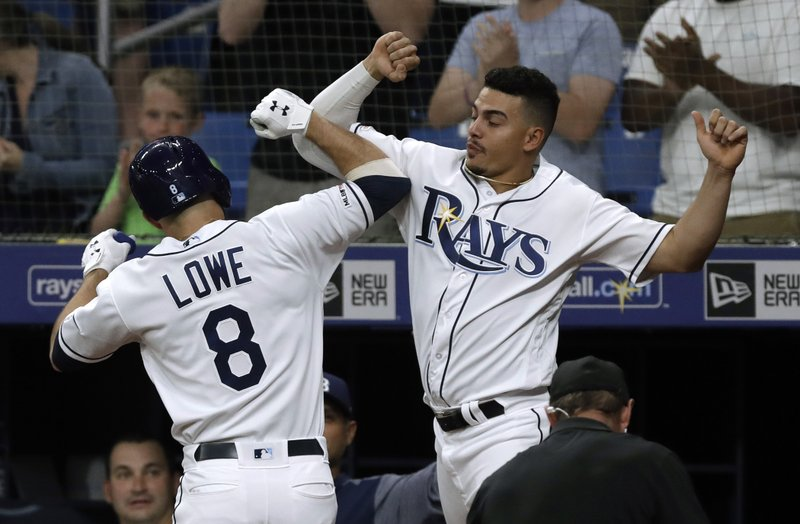 Tampa Bay Rays' Brandon Lowe (8) celebrates with Willy Adames after Lowe hit a three-run home run off Baltimore Orioles pitcher David Hess during the first inning of a baseball game Wednesday, April 17, 2019, in St. (AP Photo/Chris O'Meara)