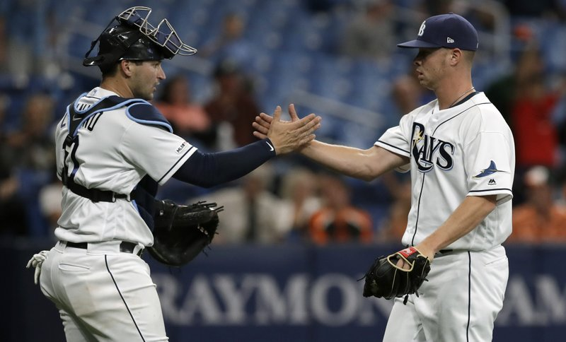 Tampa Bay Rays pitcher Emilio Pagan, right, celebrates with catcher Mike Zunino after closing out the Baltimore Orioles during the ninth inning of a baseball game Wednesday, April 17, 2019, in St. (AP Photo/Chris O'Meara)