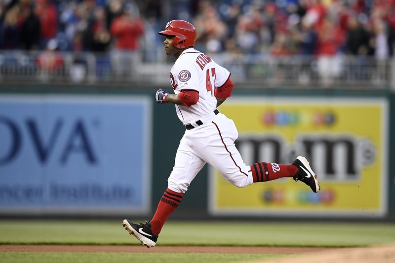Washington Nationals' Howie Kendrick rounds the bases after hitting a home run during the first inning of the team's baseball game against the San Francisco Giants, Wednesday, April 17, 2019, in Washington. (AP Photo/Nick Wass)