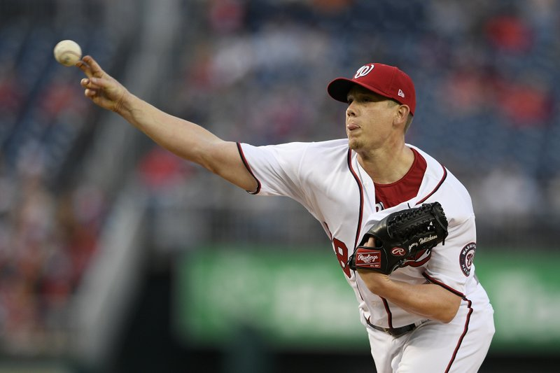 Washington Nationals starting pitcher Jeremy Hellickson throws during the first inning of the team's baseball game against the San Francisco Giants, Wednesday, April 17, 2019, in Washington. (AP Photo/Nick Wass)