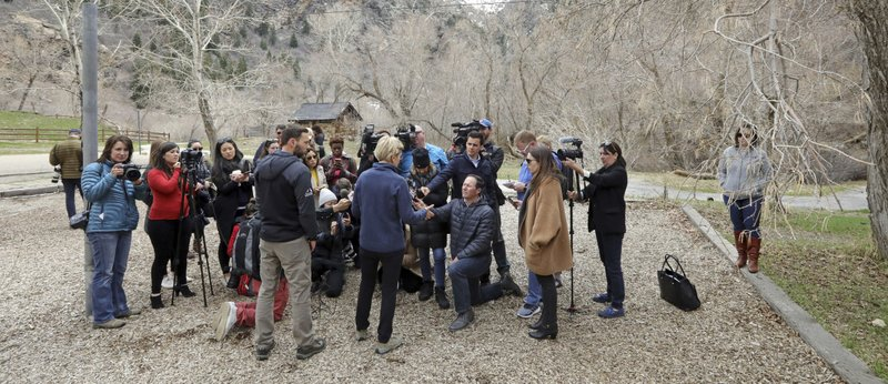 Democratic presidential candidate Sen. Elizabeth Warren, D-Mass., center, speaks with the media during an visit to Big Cottonwood Canyon Wednesday, April 17, 2019, east of Salt Lake City. (AP Photo/Rick Bowmer)