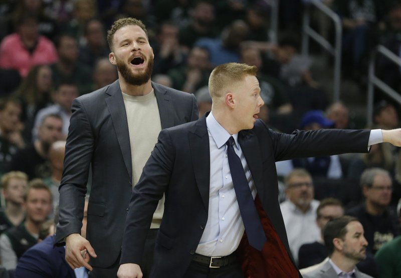 Detroit Pistons' Blake Griffin, left, reacts from the bench during the first half of Game 2 of the team's NBA basketball first-round playoff series against the Milwaukee Bucks on Wednesday, April 17, 2019, in Milwaukee. (AP Photo/Aaron Gash)