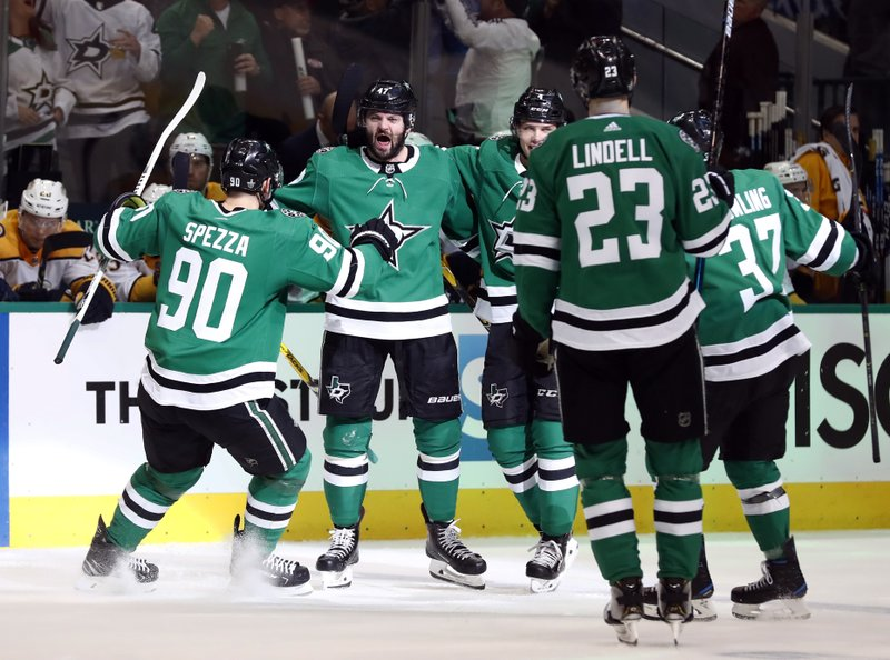 Dallas Stars' Jason Spezza (90), Alexander Radulov (47), Esa Lindell (23), Justin Dowling (37) and Miro Heiskanen (4) celebrate a goal by Radulov against the Nashville Predators in the first period of Game 4 in an NHL hockey first-round playoff series in Dallas, Wednesday, April 17, 2019. (AP Photo/Tony Gutierrez)