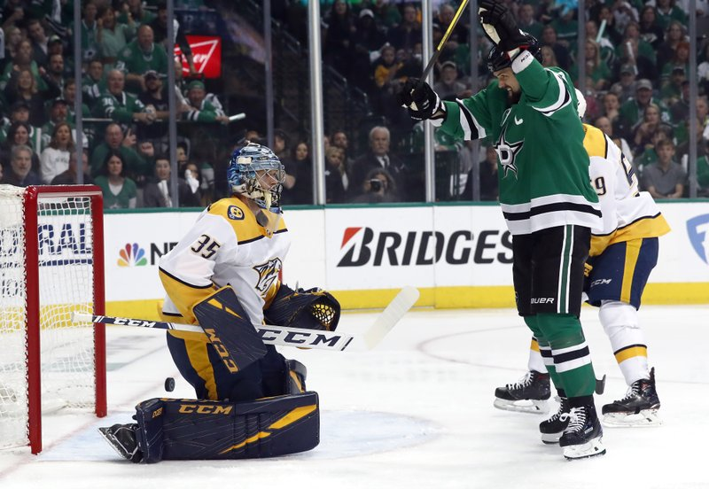 Nashville Predators goaltender Pekka Rinne (35) watches as Dallas Stars left wing Jamie Benn (14) celebrates a goal scored by Roope Hintz during the first period of Game 4 in an NHL hockey first-round playoff series in Dallas, Wednesday, April 17, 2019. (AP Photo/Tony Gutierrez)