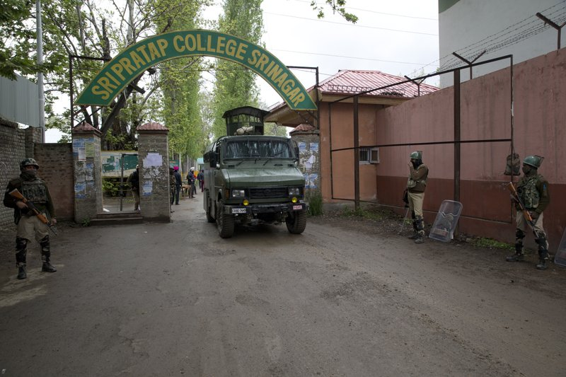 Indian paramilitary soldiers stand guard outside a polling station on the eve of the second phase of India's general election in Srinagar, Indian controlled Kashmir, Wednesday, April 17, 2019. (AP Photo/Dar Yasin)