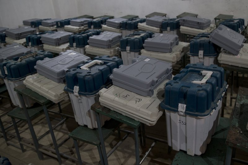 Electronic voting machines and and voter verifiable paper audit trail material lie for distribution on the eve of the second phase of India's general election inside a distribution center in Srinagar, Indian controlled Kashmir, Wednesday, April 17, 2019. (AP Photo/Dar Yasin)