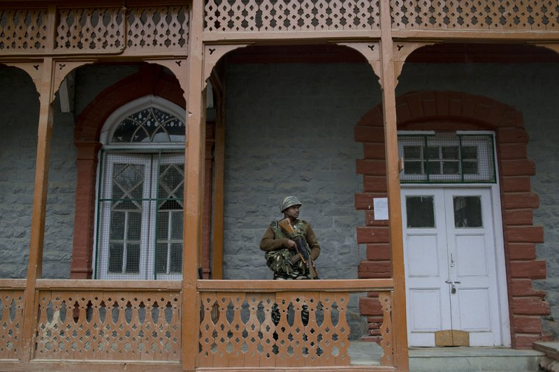An Indian paramilitary soldier stands guard outside an election material distribution center on the eve of the second phase of India's general election in Srinagar, Indian controlled Kashmir, Wednesday, April 17, 2019. (AP Photo/Dar Yasin)
