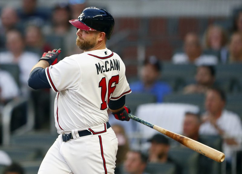 Atlanta Braves' Brian McCann follows through on a two-run double during the second inning of the team's baseball game against the Arizona Diamondbacks on Wednesday, April 17, 2019, in Atlanta. (AP Photo/John Bazemore)