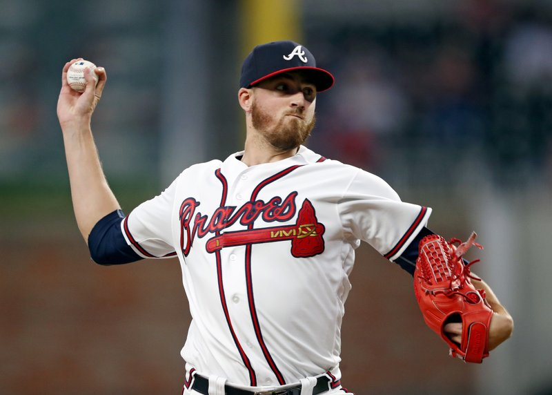 Atlanta Braves starting pitcher Kevin Gausman works against the Arizona Diamondbacks during the fourth inning of a baseball game Wednesday, April 17, 2019, in Atlanta. (AP Photo/John Bazemore)