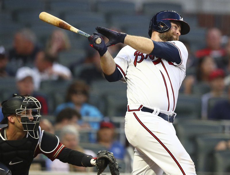 Atlanta Braves' Brian McCann follows through on a two-run double against the Arizona Diamondbacks during the second inning of a baseball game Wednesday, April 17, 2019, in Atlanta. (Curtis Compton/Atlanta Journal-Constitution via AP)
