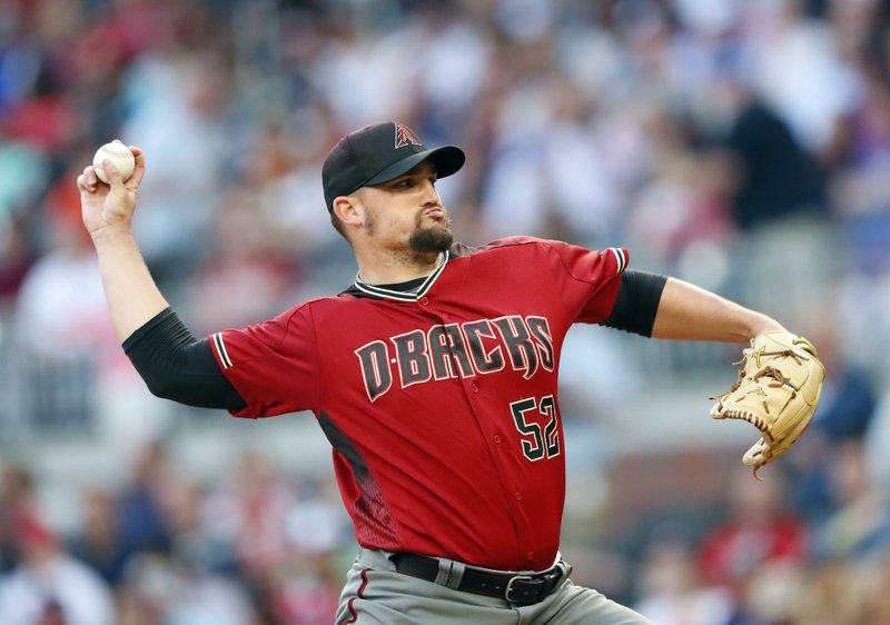 Arizona Diamondbacks starting pitcher Zack Godley (52) works in the first inning of a baseball game against the Atlanta Braves on Wednesday, April 17, 2019, in Atlanta. (AP Photo/John Bazemore)