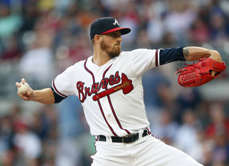 Atlanta Braves starting pitcher Kevin Gausman works in the first inning of the team's baseball game against the Arizona Diamondbacks on Wednesday, April 17, 2019, in Atlanta. (AP Photo/John Bazemore)