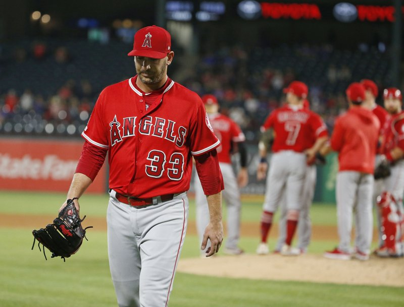 Los Angeles Angels starting pitcher Matt Harvey (33) is pulled from the game against the Texas Rangers during the fifth inning of a baseball game Wednesday, April 17, 2019, in Arlington, Texas. (AP Photo/Michael Ainsworth)