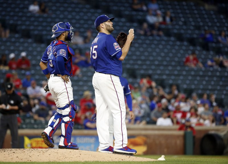 Texas Rangers catcher Isiah Kiner-Falefa (9) visits with starting pitcher Lance Lynn (35) after the base were loaded against the Los Angeles Angels during the third inning of a baseball game Wednesday, April 17, 2019, in Arlington, Texas. (AP Photo/Michael Ainsworth)