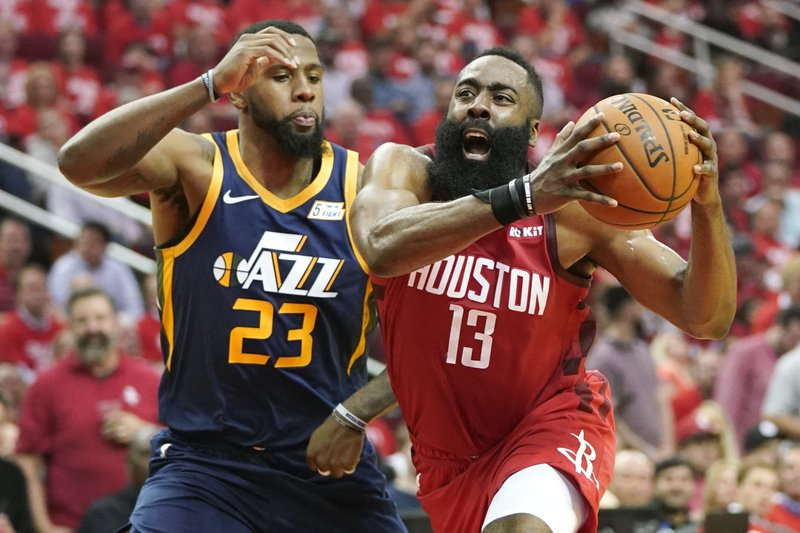 Houston Rockets guard James Harden (13) drives against Utah Jazz forward Royce O'Neale (23) during the first half of Game 2 of a first-round NBA basketball playoff series in Houston, Wednesday, April 17, 2019. (AP Photo/David J. Phillip)