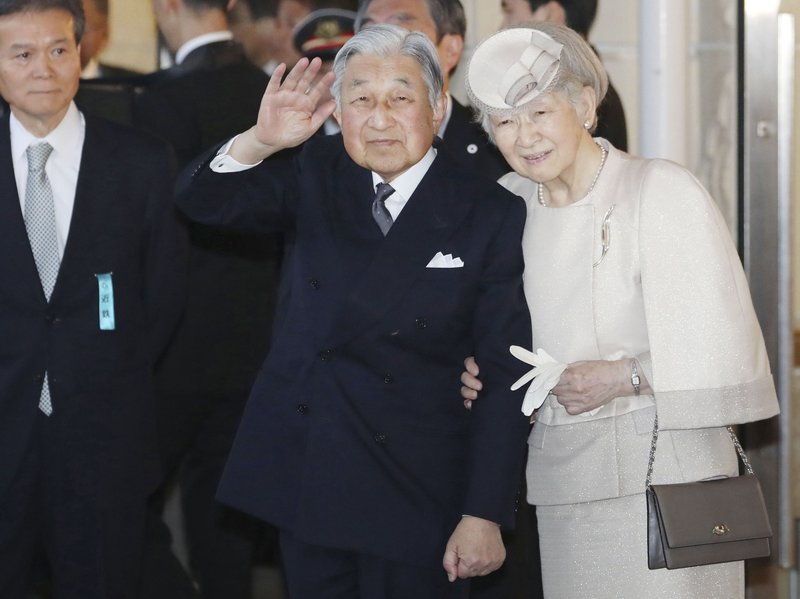 Japanese Emperor Akihito, center, and Empress Michiko, right, arrive at a station as they are scheduled to visit Ise Jingu Shrine in Ise, central Japan, Wednesday, April 17, 2019. (Kyodo News via AP)