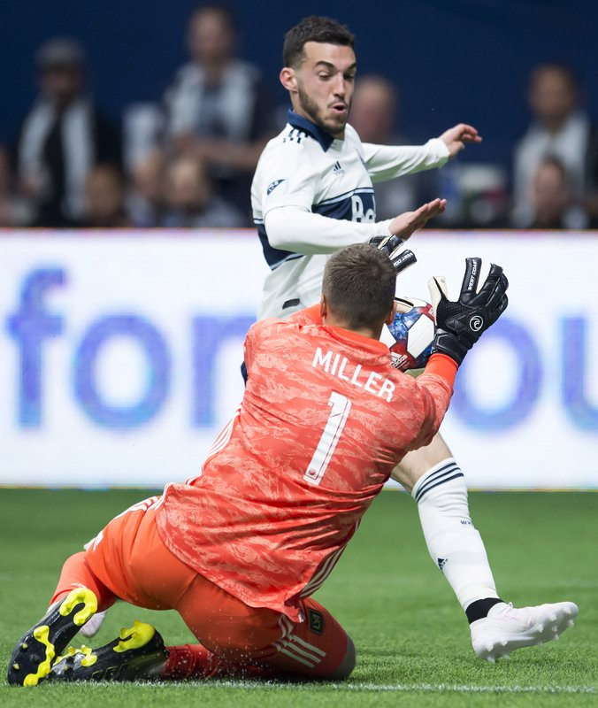 Los Angeles FC goalkeeper Tyler Miller (1) stops a shot from Vancouver Whitecaps midfielder Russell Teibert during the second half of an MLS soccer match Wednesday, April 17, 2019, in Vancouver, British Columbia. (Jonathan Hayward/The Canadian Press via AP)