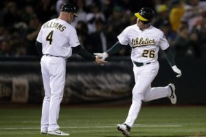 Montas pitches A's past Houston to end Astros streak